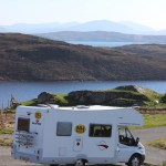 Motorhome with Scottish loch and hills